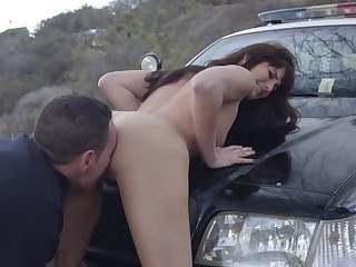 A dark haired chick is getting fucked at the end of one's tether a dude on the car