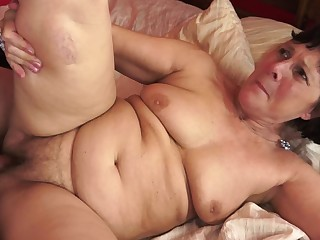A fat old granny is getting a dick wide her hairy old pussy