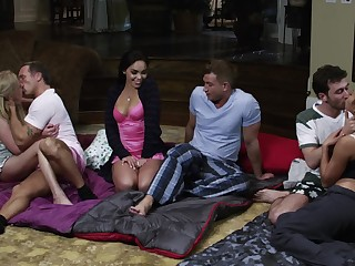 A group of people is having a sleepover with a lot of sex