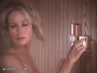 Sensual Retro White-headed Bo Derek Wearing Just a Towel Encircling a Steamy Sauna
