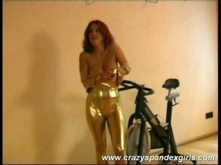 Acrobatic bitch reveals jugs, stripping off her tight gold suit