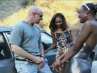 Two sexually excited ebony sucks a muscle dude's 10-Pounder !