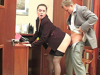 Passionate secretary in gentle tights getting hammered right on her working table