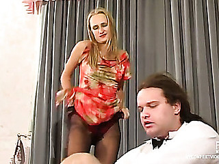 Pantyhosed sweetheart in spike heel shoes getting to trampling and giving footjob