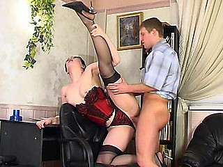 Cutie in barely darksome stockings reachable be incumbent on anything to entice her co-worker