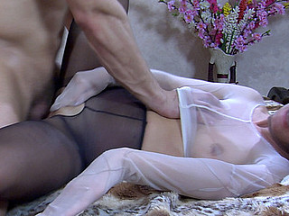 Sexy beauty in a hose mask and full-body encasement boned by a nylon freak