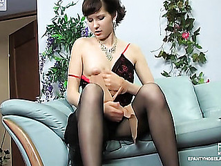 Miasmic unfocused caressing her moist hallow tunnel with the hand clad in nylon pantyhose