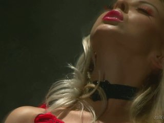 Slender blonde babe Lea Tyron dressed in red plays with herself in the dark. She rubs her pussy with her hawt red panties on. She's full of passion doing it.