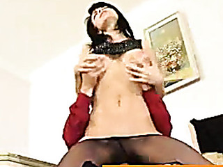 Slutty female co-worker in barely black pantyhose longing for schlong-break