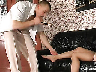 Wanton sweetheart massaging 10-Pounder with her nyloned feet crying out for steamy sex