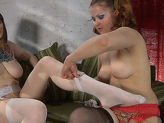 Hawt lesbo changes her striped nylons to black ones previous to lesbo sex