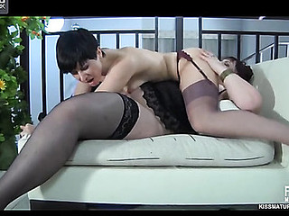 Buxom older lesbian makes passes at a younger cutie for some pussy fisting
