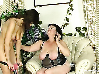 Crummy aged chick getting her mellow twat drilled by strap-on armed hottie