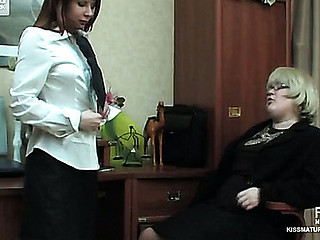 Overweight aged business woman and female co-worker acquiring down into lesbian