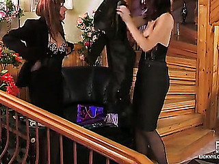 Clad in black secretaries trying recent corsets and stockings for muff lapping