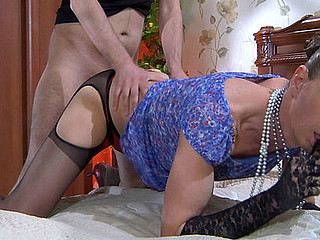 Dressed like a lady sissy putting his mouth and rear to work in chap-on-chap