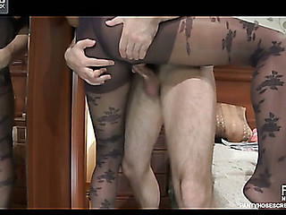Dolled-up chick changes into dark rose pattern hose for a bedroom fuck