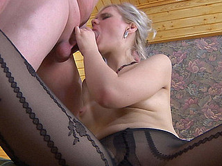 Glamour gal in patterned pantyhose gets widen on a ottoman for mighty dicking