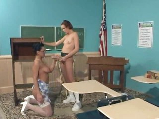 Girls in classroom have strapon coition