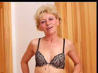 Skinny golden-haired cougar Susan Lee masturbates on a bar stool