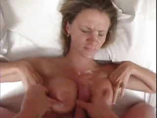 Titjob and a large ejaculation for the stunner