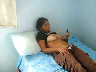 A very large boob indian teen girl lets me make a movie as that babe texts a friend during the time that her top is rolled up and that babe puss down her pants and pants revealing her hairy crotch