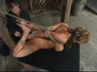 Busty bitch tied up and used by her corporalist