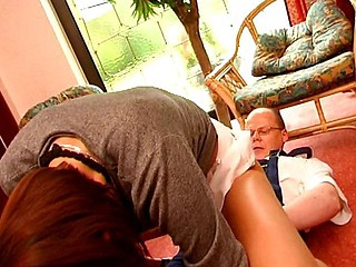 Brunette takes on an older guy's penis and blows before he drills her