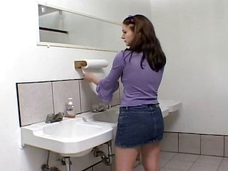 Brunette has a panacea in the bathroom and blows and gets nailed