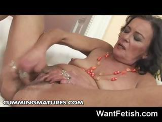 Mature brunette granny loves to finger her pussy and use big dildos