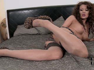 Leggy Becky Holt strips surrounding th