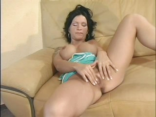 Busty Sabrina Dotee rubs her cleanly shaved slit
