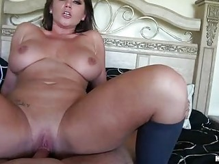 Coarse brunette milf with large balloons rides hard weiner in bedroom