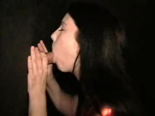 Gloryhole playgirl in a shiny top sucks and fucks
