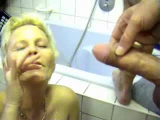 Milf receives him off in her bathroom