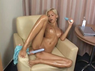 She oils up her body and plays with toys