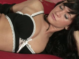 Sweet brunette Tess Lyndon strips out of her black lingerie on her pink bed and masturbates eagerly on camera. This babe rubs her trimmed pussy before taking toy is her avid love hole.