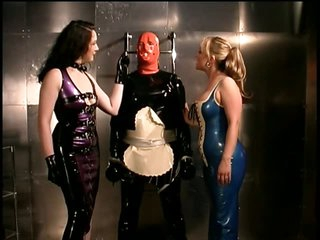 Bizarre Dominatrices With a Latex Charm Block up a Submissive Male
