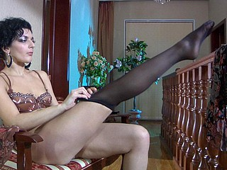 Hawt dark brown hair operose on several garter belts and stockings be useful to a brown out