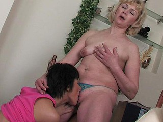 Lesbian chick willingly dropping on her knees to smack a ripe older fur pie