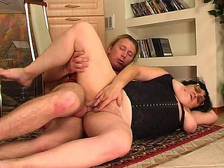 Chubby older gal goes for a juvenile guy lusting for some fresh hard meat