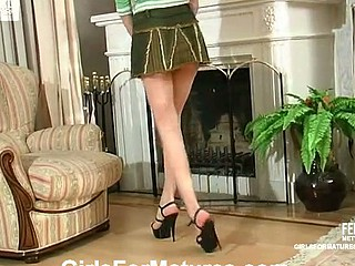 Leggy beauty in hot petticoat tempted to try a fresh sex toy by slutty older babe