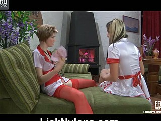 Vivacious sappho in nurse uniform and red stocking inspects a honey