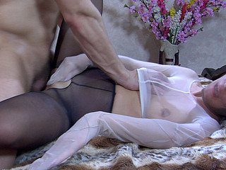 Hawt gal in a hose mask and full-body encasement boned by a nylon freak