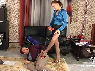 Steamy chick massaging make an issue of a-hole of the brush co-worker with strap-on and anal beads