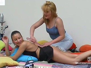 Older gal seducing her younger girlfriend procure double pretend penis fun on the ottoman