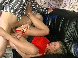 Blondie in red high heel shoes and barely visible hose getting horny