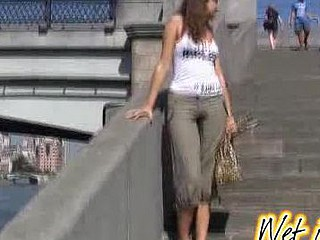 Chick wets herself on a city embankment