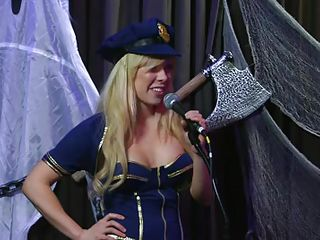 Playboy Radio's Morning Show has some of the hottest women you've ever seen! They're talking about Halloween costumes, and their guest has a cop outfit on that looks sexy as hell. It acquires even sexier when her top comes off, baring her tits. The female host comes over and helps shorten the skirt.