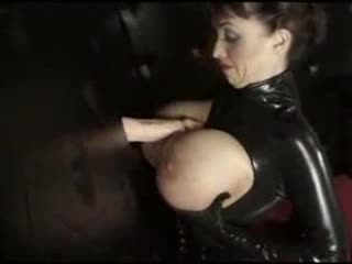 Huge tit sweetheart in latex gives gloryhole blowjob